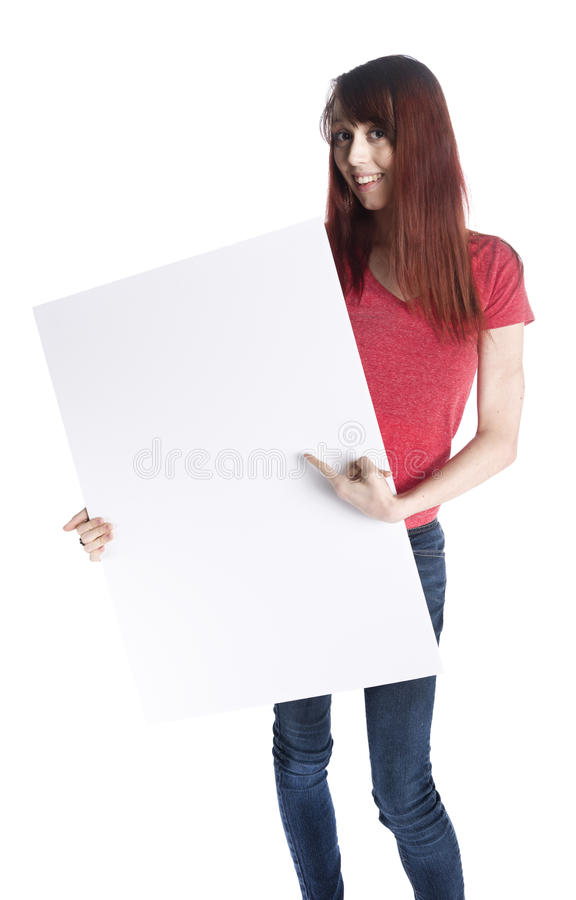 Happy Woman Holding Empty White Card Board. Full Length Shot of a Happy Young Woman in Casual Clothing Holding an Empty White Large Cardboard,Emphasizing Copy royalty free stock photos