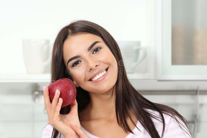 Happy woman holding fresh apple stock photography