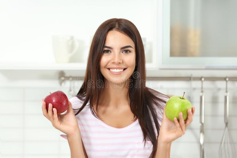 Happy woman holding fresh apples royalty free stock photography