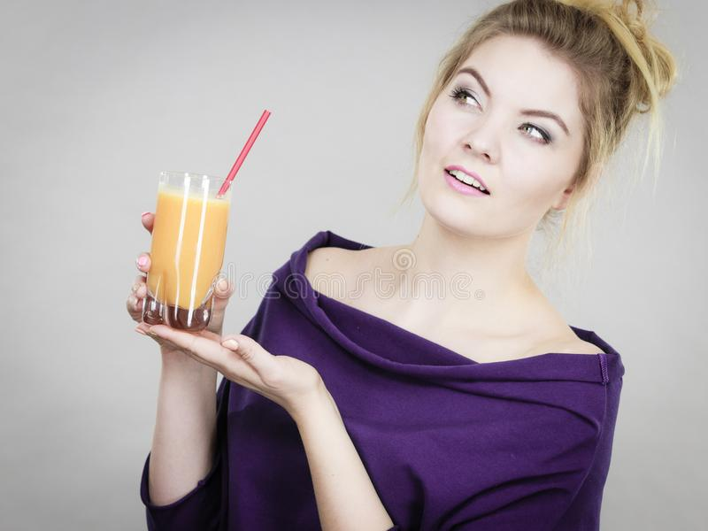 Happy woman holding fresh orange juice. Happy woman holding fresh orange grapet juice. Healthy t drink smoothies concept royalty free stock images