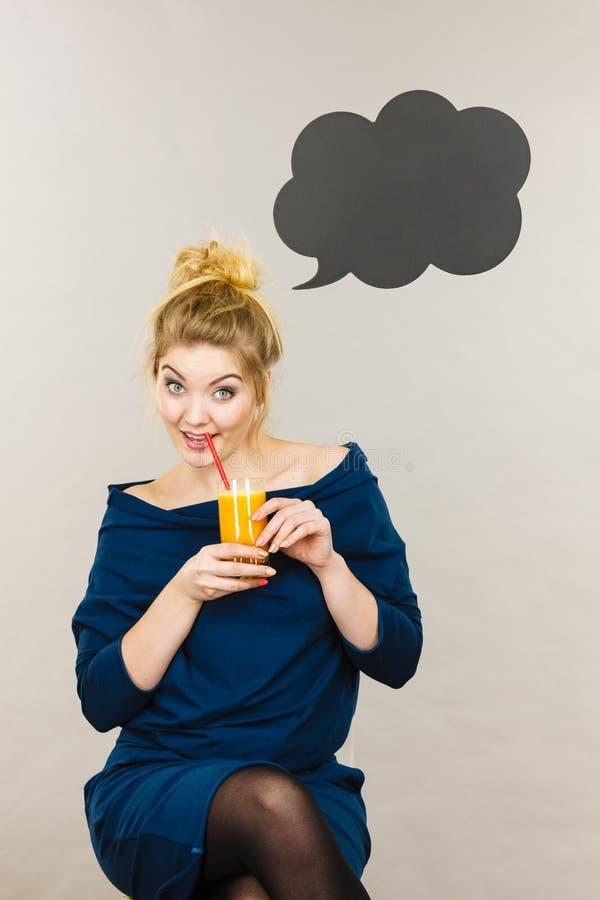 Happy woman holding fresh orange juice stock images