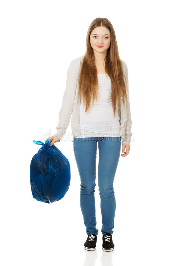 Happy woman holding a full garbage bag. royalty free stock photo