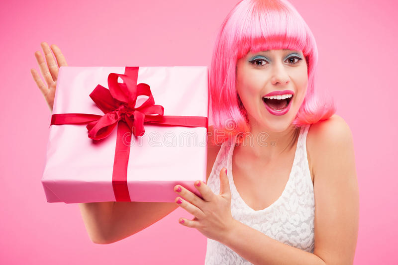 Happy Woman Holding Gift Stock Photography