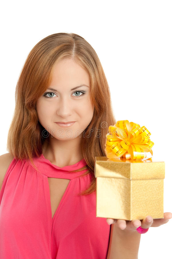 Happy woman holding a gift box. White background stock photo