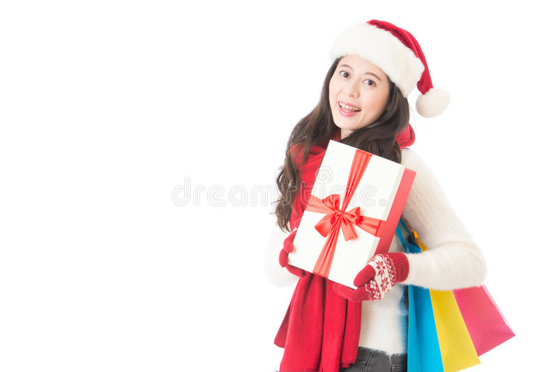 Happy woman holding gifts box and shopping bag royalty free stock images