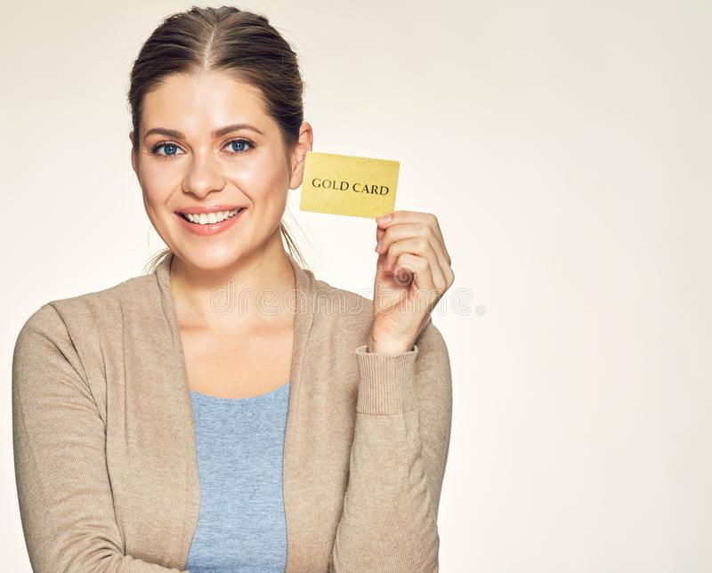 Happy woman holding gold credit card. stock photos