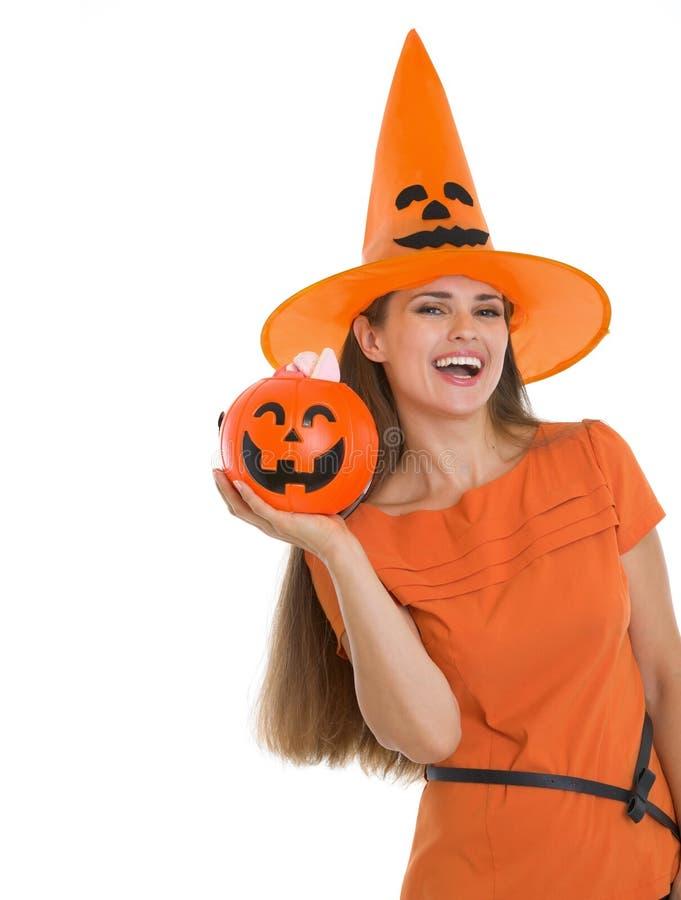 Happy woman holding Halloween bucket. Isolated on white stock photo