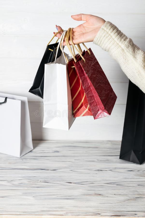 Happy woman holding in hand shopping package. Paper bag. Sale in store. Customer buy present. Black friday sale. Holiday special stock photography