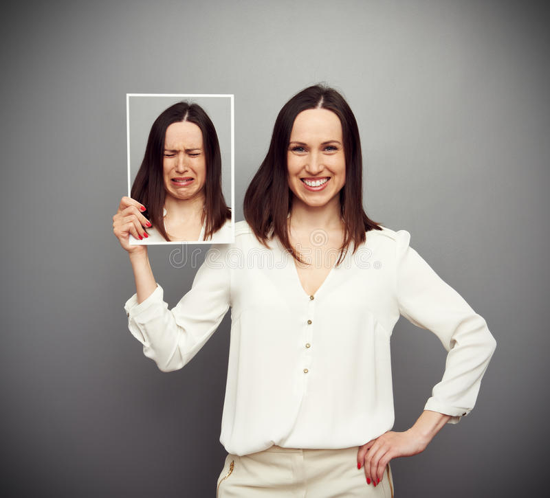 Download Happy Woman Holding Her Sad Picture Stock Photo - Image of hypocrisy, studio: 30414644