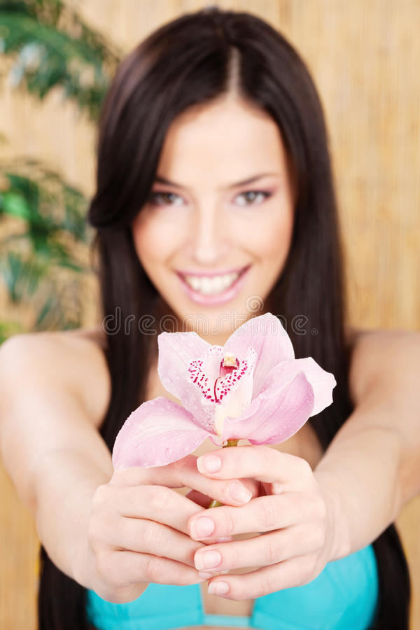 Download Happy Woman Holding Orchid, Focus On Flower Stock Photo - Image: 26945862