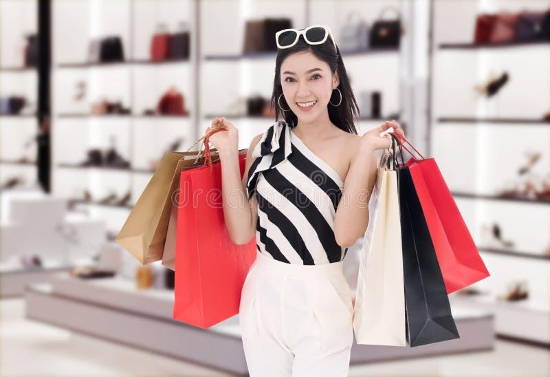 happy woman holding shopping bag at mall royalty free stock photo
