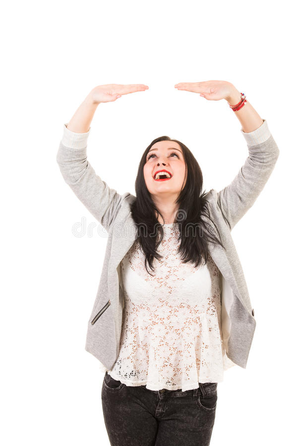 Happy woman holding something imaginary stock photos