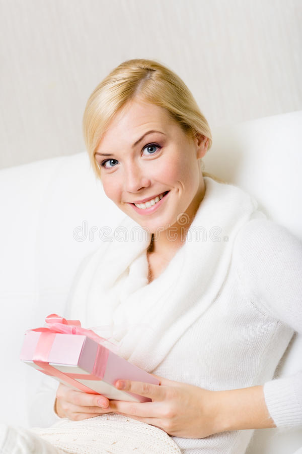 Download Happy Woman Holds A Present With Pink Ribbon Stock Photo - Image: 28494986