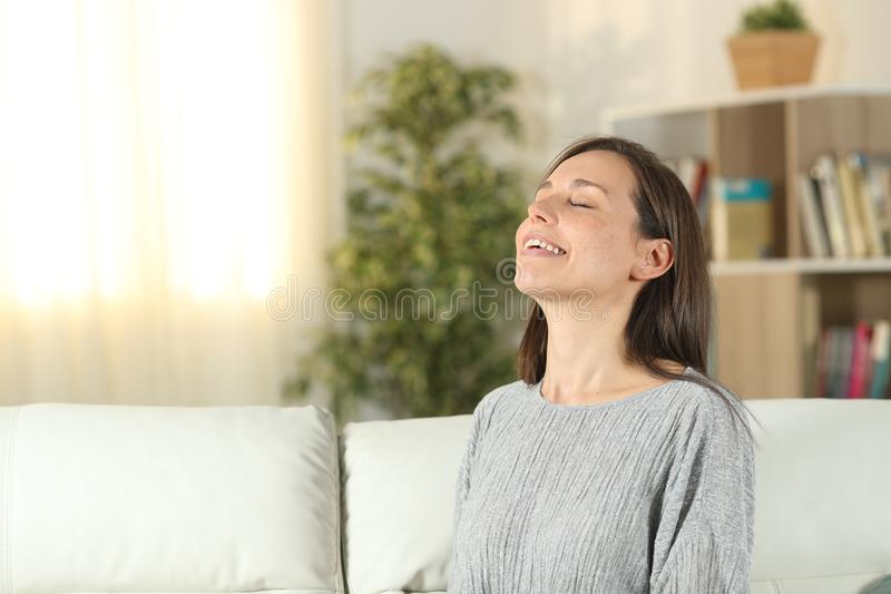 Happy woman at home breathing fresh air royalty free stock photography