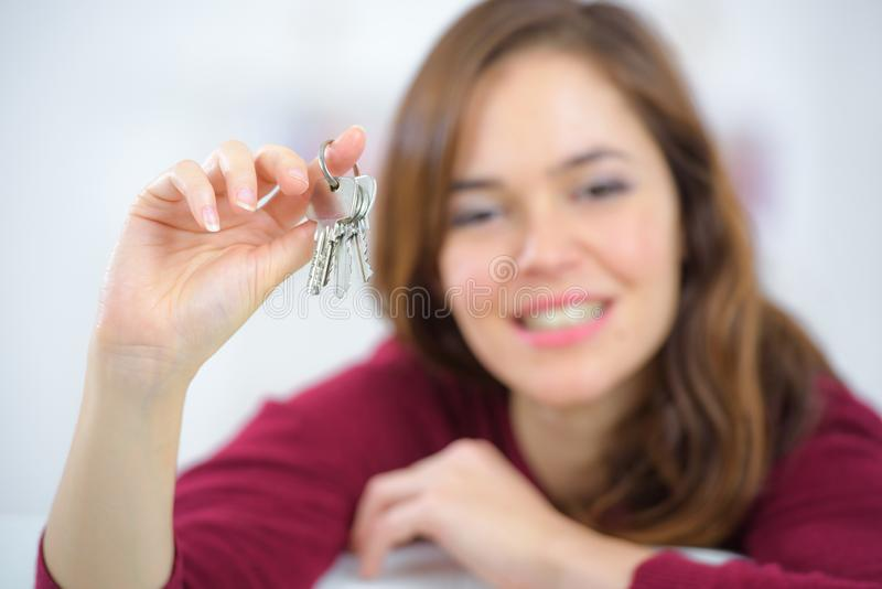 Happy woman with home key royalty free stock photography
