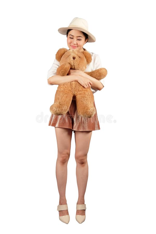Happy woman hugging a big teddy bear. On white background with clipping path royalty free stock image