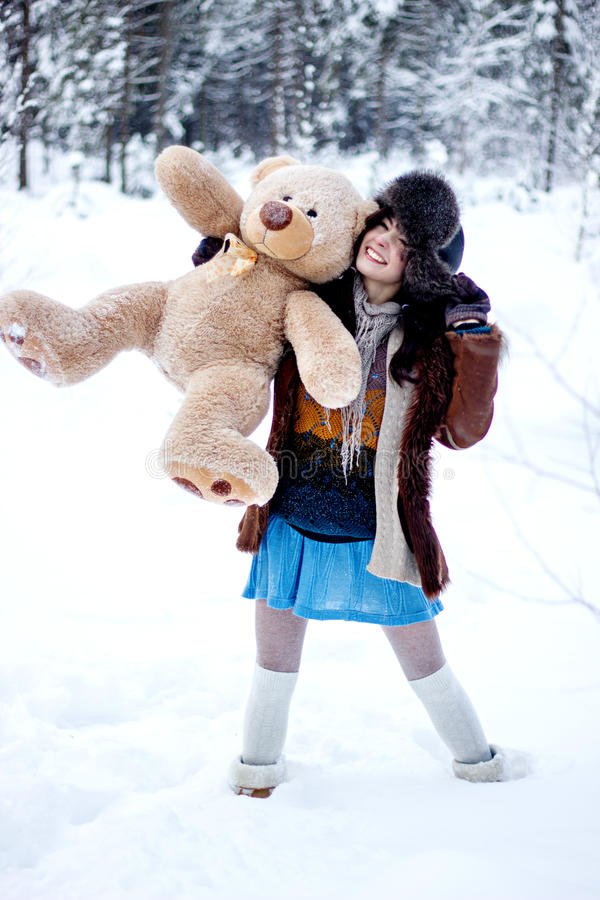 Free Happy Woman In Fur Coat And Ushanka With Bear On White Snow Winter Background Stock Photo - 36040190