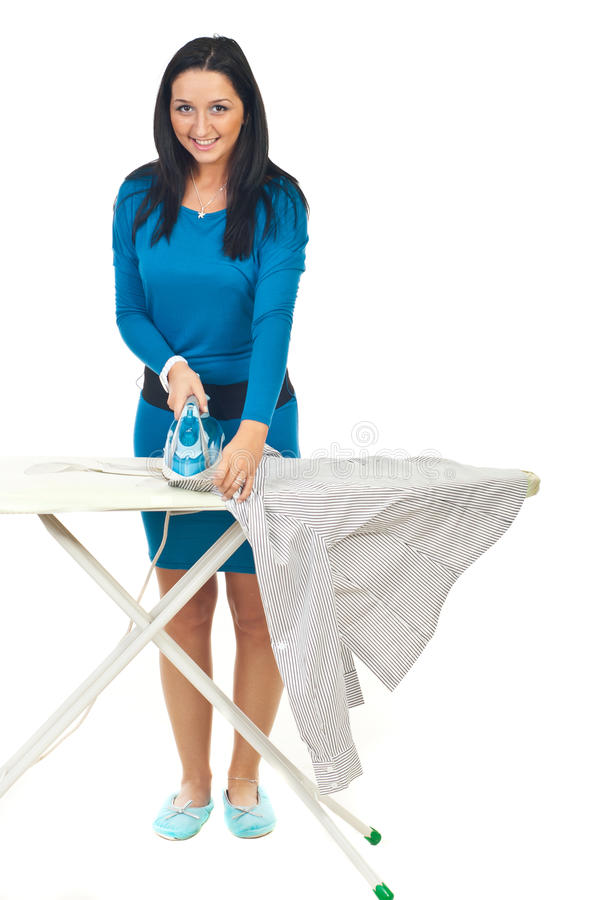 Happy woman ironing royalty free stock images