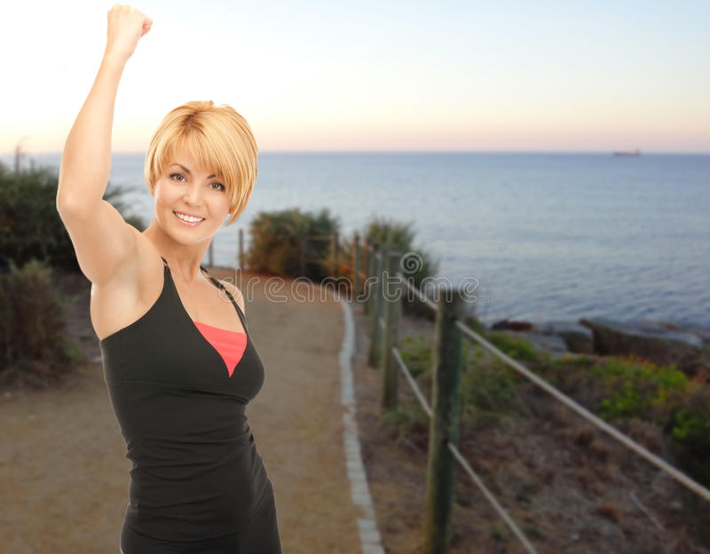 Happy woman jogging outdoors over beach background royalty free stock photos
