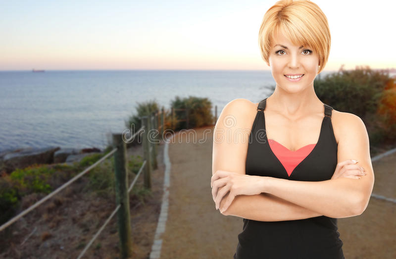 Happy woman jogging outdoors over beach background royalty free stock photo