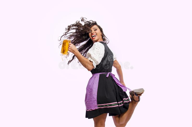 Happy woman jumping with beer mug stock photography