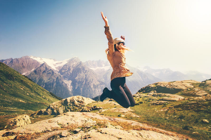 Happy Woman jumping up Flying levitation stock photo