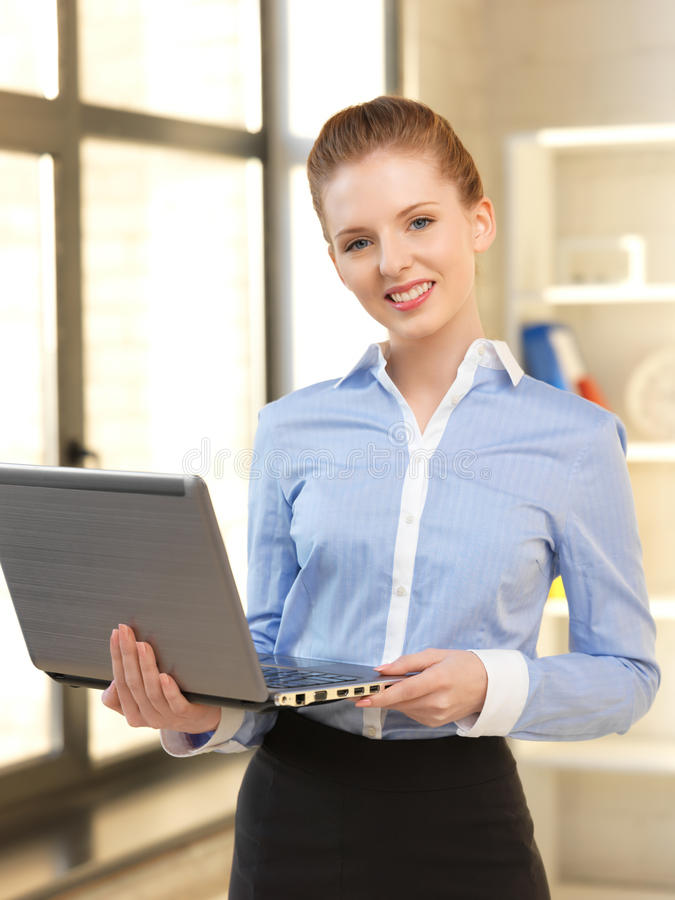 Happy woman with laptop computer. Bright picture of happy woman with laptop computer stock images