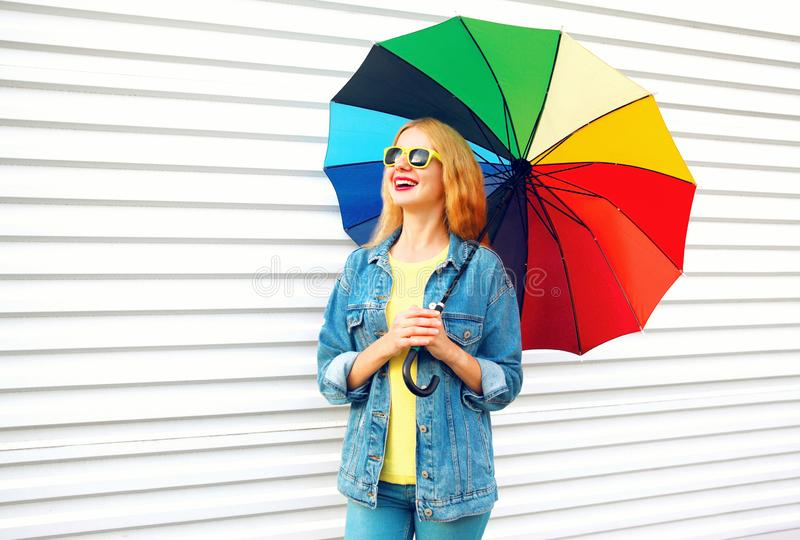 Happy woman laughing holds colorful umbrella, dreams on white stock images