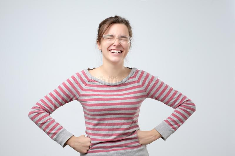 Woman laughing smiling with perfect smile and white teeth looking happy royalty free stock images