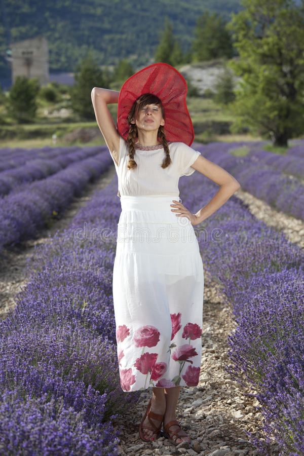 Happy woman in lavender field royalty free stock image