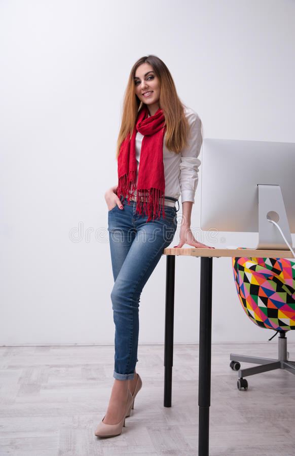 Happy woman leaning on the table stock photos