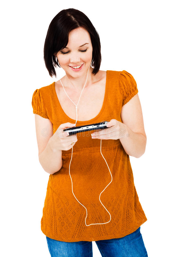 Happy woman listening media player