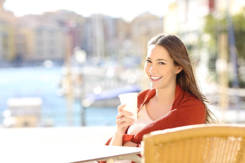 Woman looking at camera in a coffee shop stock photos