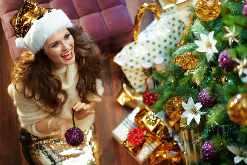 Happy woman looking at copy space showing purple Christmas ball stock photos