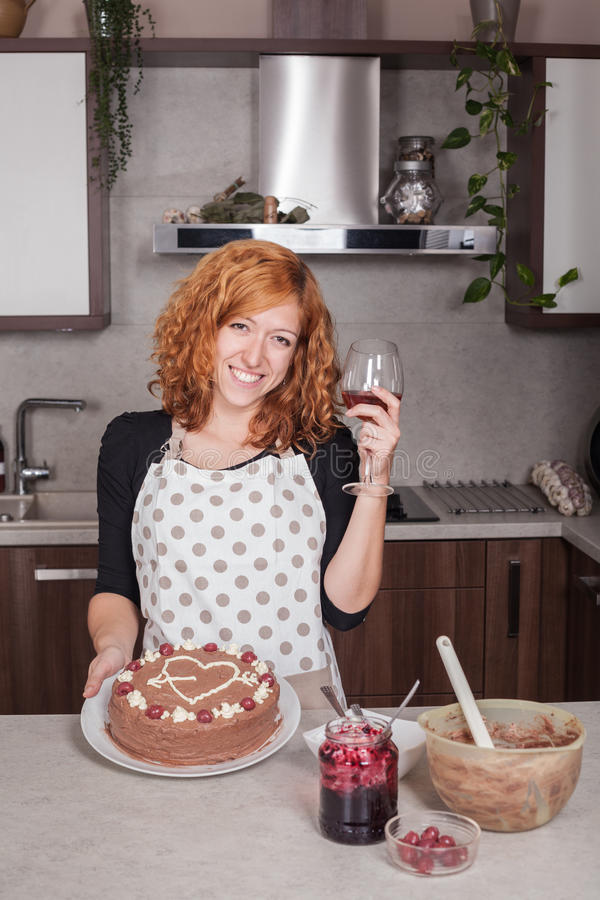 Happy woman in love showing homemade cake stock image