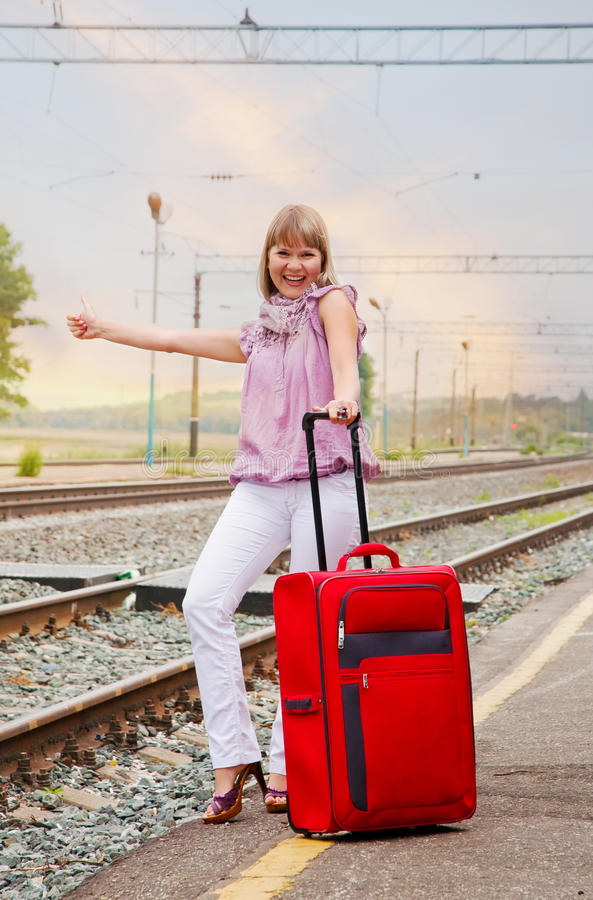 Download Happy woman with luggage stock photo. Image of stand - 21328920