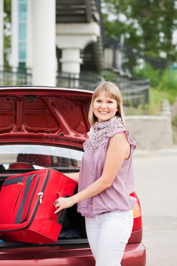 Download Happy woman with luggage stock photo. Image of asphalt - 21328932