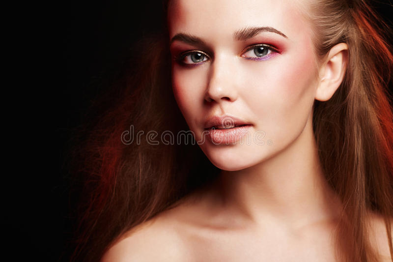 Happy woman with make-up and colorful hair. Beauty Young happy woman with make-up and colorful hair.Beautiful Girl with fashion Three-dimensional hairdo royalty free stock photography