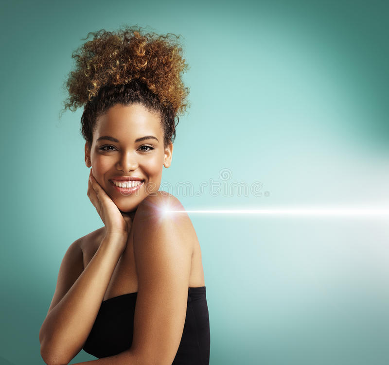 Happy woman making a laser cosmetology procedure stock photo
