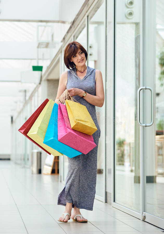 Happy Woman at the mall royalty free stock photography