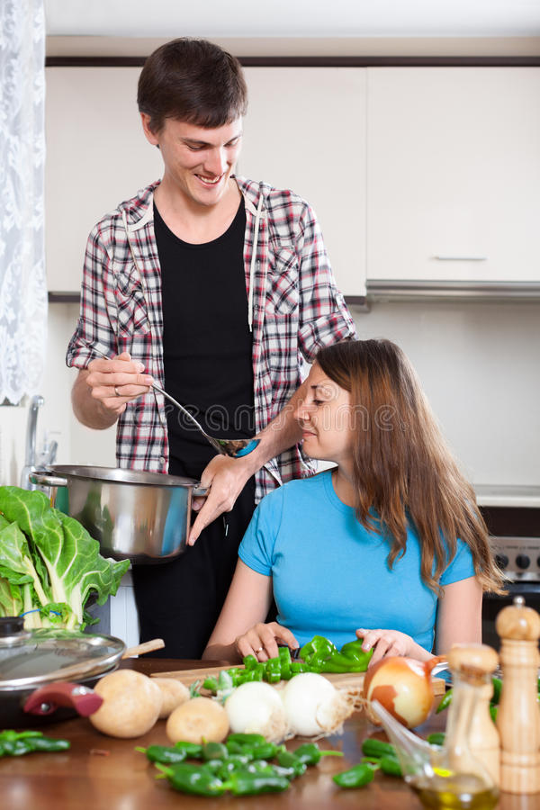 Download Happy Woman And Man Cooking Vegetables Stock Photo - Image: 40183212