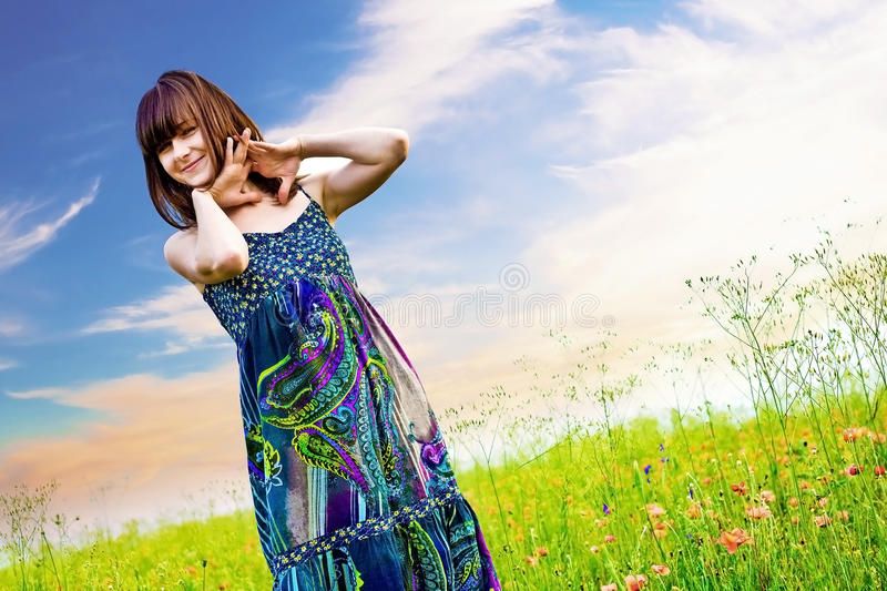 Happy woman in a meadow stock images