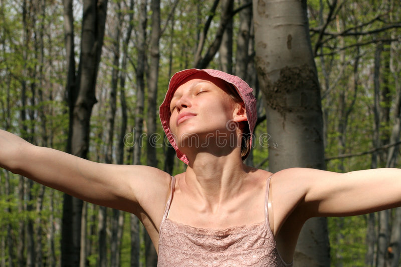 Happy woman - meditation in the forest royalty free stock image