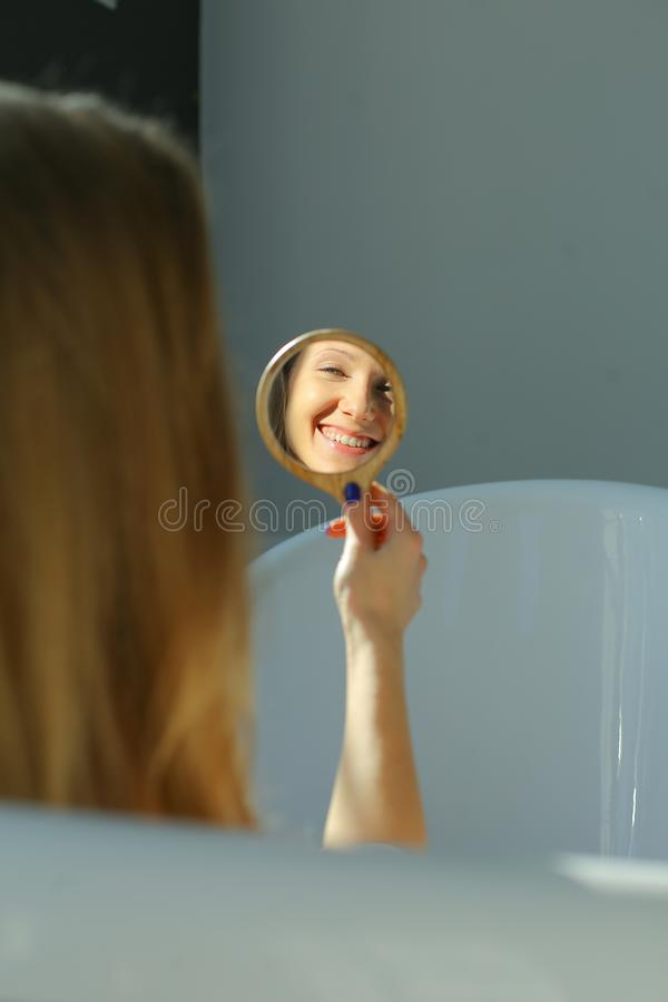 Happy woman in mirror royalty free stock photo