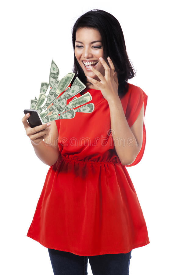 Happy woman with money from cellphone royalty free stock photo