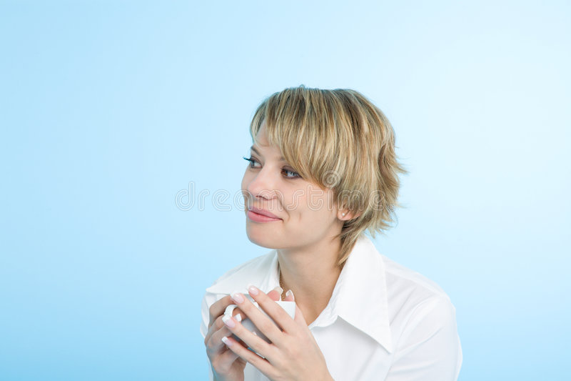 A happy woman at morning with a cup of coffee royalty free stock photos