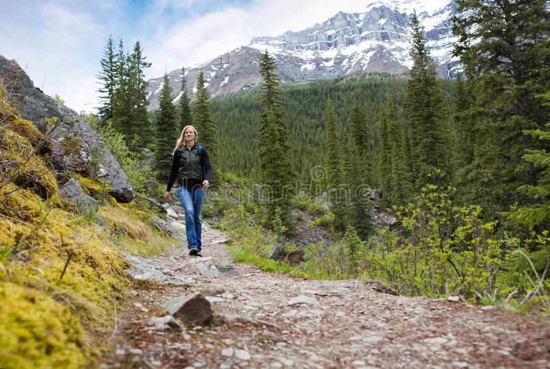 Happy Woman on Mountain Hike stock images