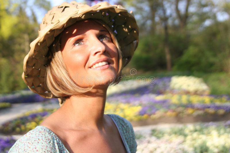 Happy woman in nature. Attractive happy beauty woman in nature royalty free stock image