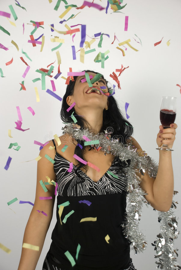 Happy woman new year party. Happy woman at a party or maybe celebration new year with wine and confetti,more photos with this model in stock photos