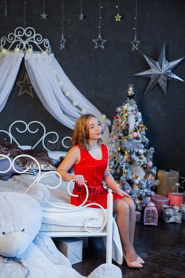 Happy woman on New Year`s bed. Happy and Merry Christmas 2020. royalty free stock image
